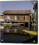 Yellow Shikara In Front Of A Run Down Area Of Houses In The Dal Lake Acrylic Print