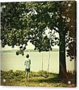 Young Boy Looking Out At The Water Under A Big Tree Acrylic Print