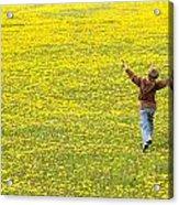 Young Boy Running Through Field Of Acrylic Print
