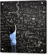 Young boy writes math equations on chalkboard Acrylic Print