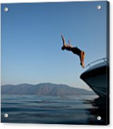 Young Man Flips Off A Boat At Sunset Acrylic Print