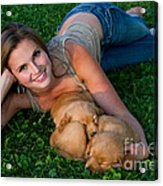 Young Woman And Golden Retriever Puppies Acrylic Print