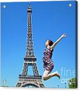 Young Woman Jumping Against Eiffel Tower Acrylic Print
