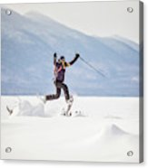 Young Woman Jumping While Snowshoeing Acrylic Print