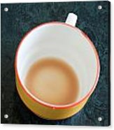 A Cup With The Remains Of Tea On A Green Table Acrylic Print