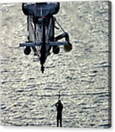 A Search And Rescue Swimmer Is Hoisted Acrylic Print
