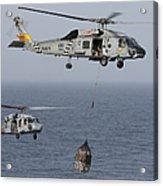 A Sh-60j Seahawk Transfers Cargo Acrylic Print