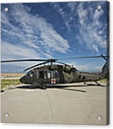 A Uh-60l Blackhawk Parked On Its Pad Acrylic Print