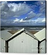 Beach Huts Under A Stormy Sky In Normandy Acrylic Print