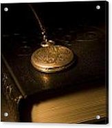 Gold Pocket Watch Resting On A Book Acrylic Print by Philippe Widling