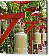 Row Of Bells In A Temple Covered By Red Umbrella Acrylic Print