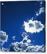 Sunlit Fluffy White Clouds In A Blue Acrylic Print