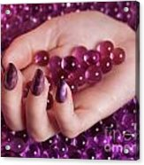 Woman Hand With Purple Nail Polish On Candy Acrylic Print