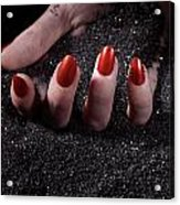 Woman Hand With Red Nails On Black Sand Acrylic Print