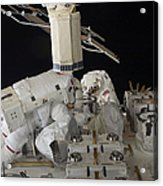 Astronauts Working On The International Acrylic Print