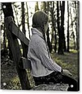Girl Sitting On A Wooden Bench In The Forest Against The Light Acrylic Print