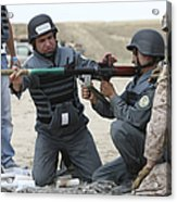 An Afghan Police Student Loads A Rpg-7 Acrylic Print by Terry Moore