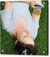 Woman Using Her Iphone Acrylic Print by Photo Researchers, Inc.