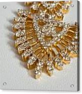 A Beautiful Gold And Diamond Pendant On A White Background Acrylic Print