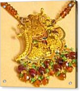 A Beautiful Intricately Carved Gold Pendant Hanging From A Semi-precious Stone Chain Acrylic Print