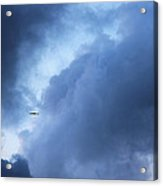 A Bird Flying In Cloudy Sky Acrylic Print by Gal Ashkenazi