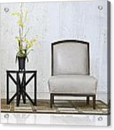 A Chair And A Table With A Plant  Acrylic Print