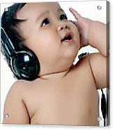A Chubby Little Girl Listen To Music With Headphones Acrylic Print
