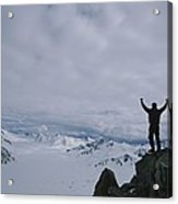 A Climber Raises His Arms In Triumph Acrylic Print