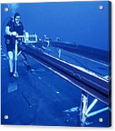A Crewman Cranks Out The Dry Deck Acrylic Print by Michael Wood