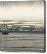 A Double-masted Sailboat Floats Near An Acrylic Print