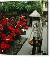 A Fruit Vendor In A Conical Hat Passes Acrylic Print by Justin Guariglia