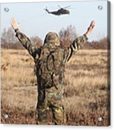 A German Army Soldier Guides A Ch-53gs Acrylic Print