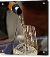 A Glass Of White Wine Being Poured Acrylic Print