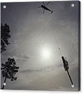 A Helicopter Lifts Cut Timber Acrylic Print