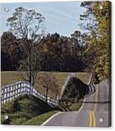 A Hilly Country Road Passes A Fenced Acrylic Print