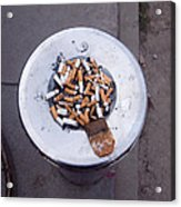 A Lot Of Cigarettes Stubbed Out At A Garbage Bin Acrylic Print