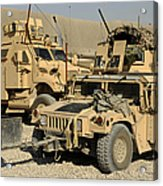 A M1114 Humvee Sits Parked In Front Acrylic Print