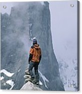 A Man Stands On A Cliff Watching Acrylic Print