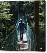 A Man Walks Across A Suspension Bridge Acrylic Print by Taylor S. Kennedy