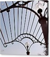 A Metal Structure That Is Part Of The Lamp Shade Arrangement In A Garden Acrylic Print