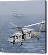 A Mh-60s Knighthawk Conducts A Vertical Acrylic Print by Gert Kromhout