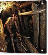 A Miner Works His Way Through A Jumble Acrylic Print by Randy Olson