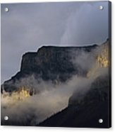 A Mountain Peaks Through The Clouds Acrylic Print