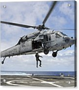 A Naval Aircrewman Is Hoisted Into An Acrylic Print