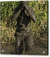 A Participant Wipes Mud From His Face Acrylic Print