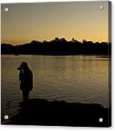 A Photographer At Work During Sunset Over A Lake Acrylic Print