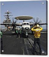 A Plane Director Guides An E-2c Hawkeye Acrylic Print