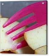 A Plastic Fork Being Used To Cut Into A Piece Of Cut Apple Pieces Acrylic Print