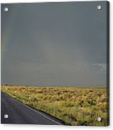 A Rainbow Touches A Rain Soaked Road Acrylic Print