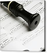 A Recorder Lying On A Book Of Sheet Music Acrylic Print by Studio Blond